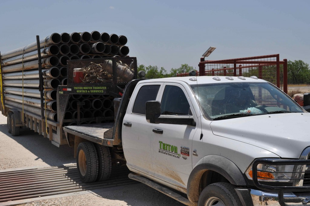 Here come the Triton water supply & Rental Co to finish the installation of Frac Pipes 2 miles of it.