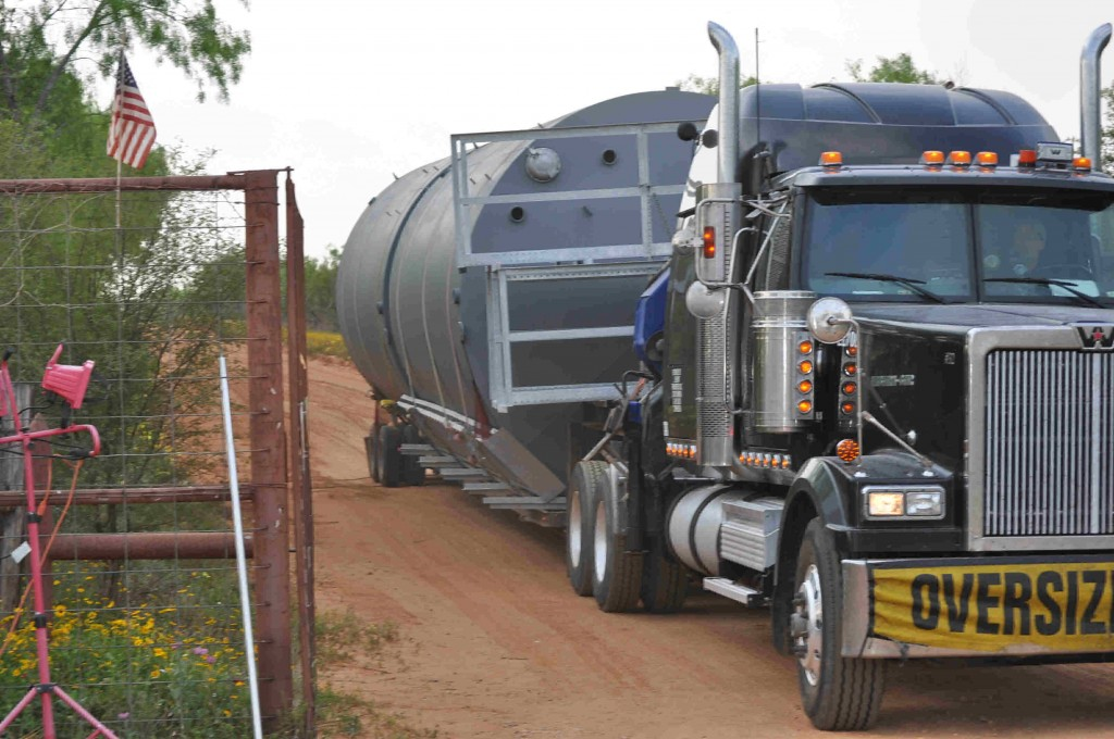 Tanks arrive for Tank farm that will receive the oil when the flow starts